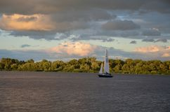 Yacht on the picturesque riverbank. Yacht (Sailing ship) on the Dnieper river (Dnepr), Ukraine royalty free stock image
