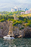 The yacht is a rocky shore Royalty Free Stock Images