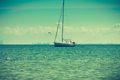 Yacht sail boat on calm sea water Stock Photography