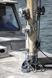 Yacht sailboat mast detail with pulleys and cleats Stock Image