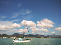 Yacht Sailboat at sea in the beautiful sky Royalty Free Stock Photography