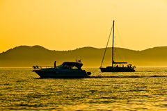 Yacht and sailboat silhouette at golden sunset Stock Photography