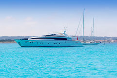 Yacht and sailboats anchor in formentera illetas. Boats yacht and sailboats anchor in formentera illetas beach Balearic islands Royalty Free Stock Photography