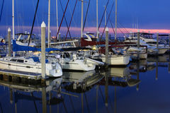 Yacht and Sailboats in the marina at sunset Royalty Free Stock Images