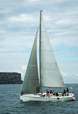 Yacht sailing. White yacht with crew, location: Manly (Sydney), Australia Stock Image