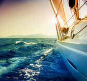 Yacht Sailing. Against sunset. Sailboat. Travel stock image