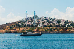 Yacht sailing in Aegean sea. Seascape with anchored sailboat off the beach in Bodrum, Turkey stock photo