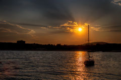 Yacht sailing against sunset. Holiday lifestyle landscape with s Royalty Free Stock Images