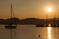 Yacht sailing against sunset. Holiday lifestyle Royalty Free Stock Images