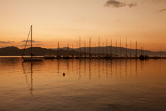 Yacht sailing against sunset. Holiday lifestyle Stock Images