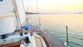 Yacht Sailing against sunset. Sailboat. Yachting stock video