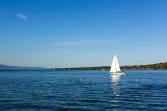 Yacht sailing on a blue lake Stock Image