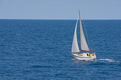 Yacht sailing in blue ocean Royalty Free Stock Photo