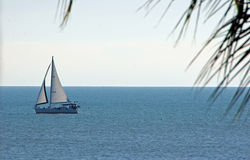 Yacht sailing on blue sea Royalty Free Stock Photo