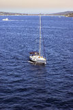 Yacht sailing in blue sea royalty free stock images
