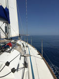 Yacht sailing blue sky sea horizon Stock Image