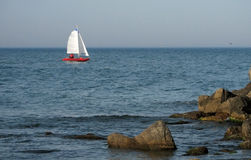 Yacht - Sailing boat in sea. Yacht in the sun light Royalty Free Stock Image