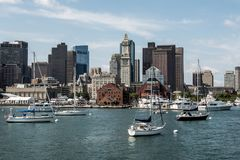 Yacht and sailing boats on Charles River in front of Boston Skyline in Massachusetts USA on a sunny summer day. Yacht and sailing boats on the Charles River in royalty free stock photos