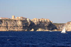 Yacht sailing into Bonifacio harbor in Corsica Stock Images