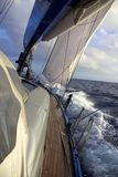Yacht sailing in choppy sea Stock Photography