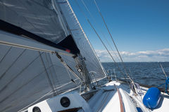 Yacht sailing with full sails Stock Images