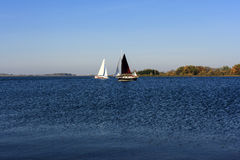 Yacht sailing on lake Stock Images