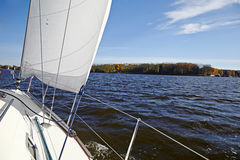 Yacht. Sailing on the lake in autumn sunny day. Stock Photo