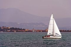 Yacht sailing on Lake Garda Stock Images