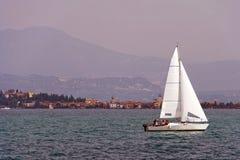 Yacht sailing on Lake Garda stock images