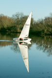 A yacht sailing on a lake Stock Images