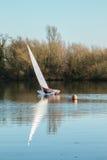 A yacht sailing on a lake Royalty Free Stock Photos