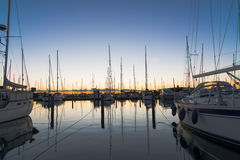 Yacht sailing Marina. A beautiful, large and luxury Marina in Germany at the Baltic Sea. There are many expensive sail ships and catamarans at this beautiful Royalty Free Stock Image