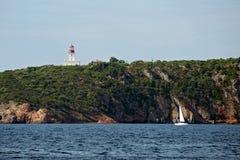 Yacht sailing near La Chiappa lighthouse Stock Photo