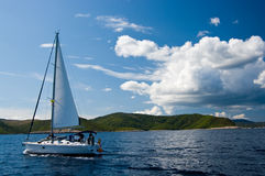 Yacht sailing near shore Stock Photos