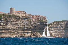 Yacht sailing near town Bonifacio, Corsica Stock Photography