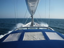 Yacht sailing on ocean. Prow of modern yacht sailing on ocean royalty free stock images