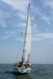Yacht sailing on ocean Stock Photos