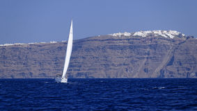 Yacht sailing off Santorini island Stock Photography