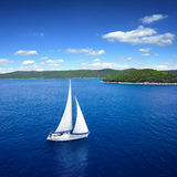 Yacht sailing on open sea at windy day stock photos