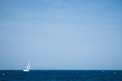 Yacht sailing on open seas. White yacht sailing on open seas Royalty Free Stock Photography