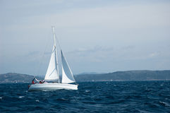 Yacht sailing on open seas Stock Photo