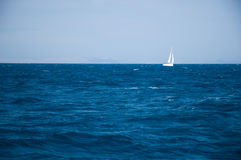 Yacht sailing on open seas Stock Images