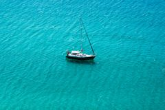 Yacht sailing in open transparent blue sea stock photos