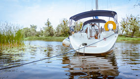 Yacht sailing on a river Royalty Free Stock Photography