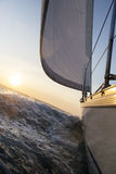 Yacht Sailing In Rough Sea Stock Images