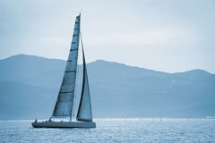 Yacht sailing on the sea Stock Photos