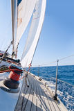 Yacht sailing in the sea Stock Images