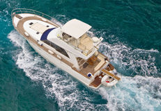 Yacht sailing on sea aerial view Stock Photos