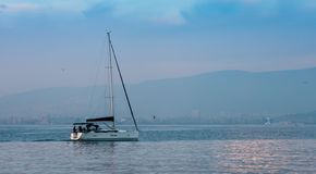 Yacht Sailing in The sea with Blue Sky, Copy Space for Text. royalty free stock photography