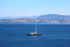 Yacht sailing on the sea. Ionian sea. Sea and mountain view Royalty Free Stock Photos